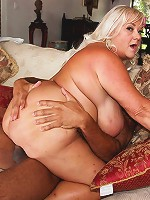 Shugar is one hot mature blonde plumper babe. She loves to take on big black cock. Her huge natural rack of tits and big belly got some love before the chocolate stick went into her mouth.