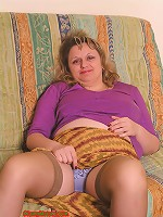 Cute chubby in stockings shows her tits and pussy