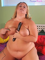 Chubby blonde massages clit while dildoing herself