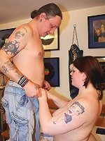 Tattoed fat slut getting naked and sucking a cock