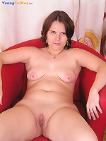 Chubby girlie massages her carefully shaven pussy