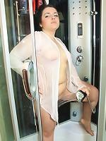 Chubby girl filmed taking shower and masturbating