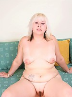 Cute blonde fatty pulls down her white bikini thongs