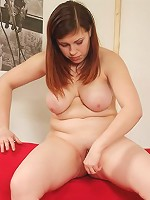 Sexy young fatty stretches her twat with a dildo