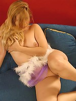 Plump model pulls down her tiny violet dress
