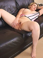 Full blondie massages her carefully shaven pussy