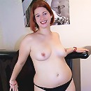 Full redhead honey takes her little red dress off