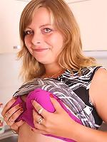 Chubby schoolgirl massages her huge heavy jugs
