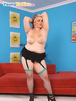 BBW redhead posing in sexy lingerie and stockings