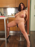 Chubby young beauty gets all naked in kitchen