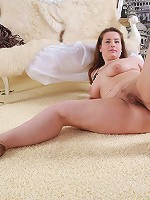 Chubby brunette candy plays with her pussy lips
