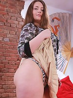 Young fatty pulls skirt up to show tiny panties