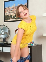 Chubby young girlie gets all naked in kitchen