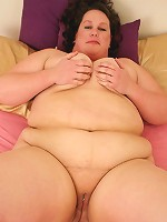 Kinky fatty having her shaven pierced slit spread for a fucking