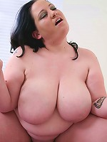 Big titted brunette letting her jugs jiggle as she rides huge cock