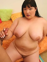 Mature asian chick playing with her plump pussy while cock sucking