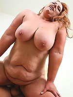 Older tanned whore riding a huge cock in the bedroom