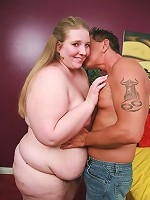 Blonde bbw Jessie showing off her big tits and spreading her fat thigh to have it licked by her partner