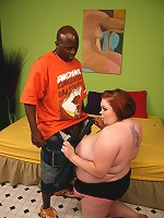 Hot brunette bbw Candice Cane slobbering a black wang before taking it deep into her gash