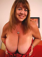 Hot brunette BBW Mercy playing with her massive tits while humping on top of a stiff cock