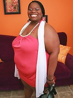 Ebony BBW Chocolat Hottie is all smiles while showing off her enormous chocolate knockers