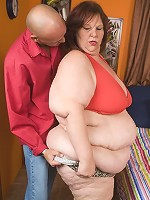 Horny BBW Sweet Cheeks makes good use of her enormous fat knockers to work a stiff wang