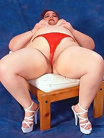 Plump in Red Panty Smiling and Squeezing Fat Tits