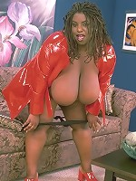 Ebony BBW in Red Suit Showing Off Heavy Hooters
