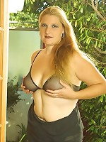 Blonde BBW Girl in See-Through Lingerie Posing