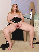 Busty blonde bbw goes solo and starts strumming her shaved pink pussy in the dining room