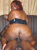 Thick ebony Afrodisia rides on top of a black schlong like a cowgirl and takes nasty cum facial