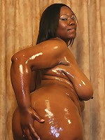 Massive ebony Tina Taboo gets greased up before taking hard cock shoving in her snatch