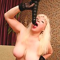 Blonde granny plugging her pussy with a huge dildo