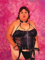 Dominatrix Looking Fat Chick Posing with Whip