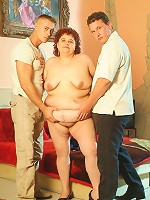 Hot bbw Gaborne rides a huge cock while sucking off another in this hot threesome