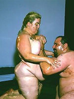 Naughty BBW covered in goo while a horny guy examines her big fat tits and enormous booty live