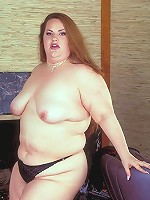 Sexy redhead taking off her clothes to show off her full bbw figure and wet snatch live