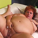 Fat redhead Sherry gets spread eagled on the couch to take a cock in her fat covered pussy live