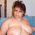 Fat babe Marta working a long meaty cock with her knockers and takes nasty cum hosing live