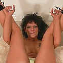 Nasty bad ass tattooed older bitch lustfully displaying her tools for the camera
