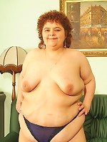 Cock starved BBW Gaborne show off her big belly and take cock cramming from both ends
