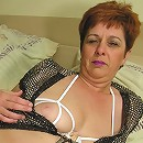 Big titted mature slut playing with her toys