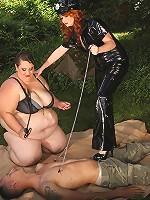 Voluptuous BBW dominatrixes torture a slave