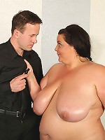 Naked and oiled up BBWs fight in the ring