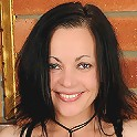 Petite 39 year old MILF Claudia K slips off her lacey thong and spreads
