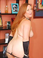 Chunky redhead takes it in the ass!