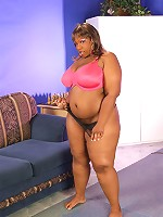 Big black BBW squeezes dick between her big fat tits!