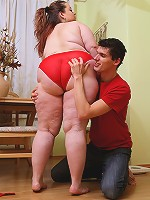 Her giant BBW butt is in red panties and he gropes it, licks it, and then fucks her cunt