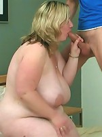 The horny fat chick sleeps in bed when the burglar comes in and he wakes her for sex