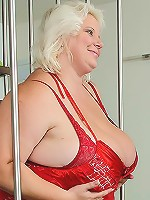 The beautiful blonde BBW has huge tits and a big ass and wears stockings during sex
